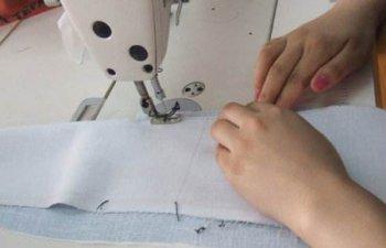 定做工作服生产当中的车缝倒回针有什么用?